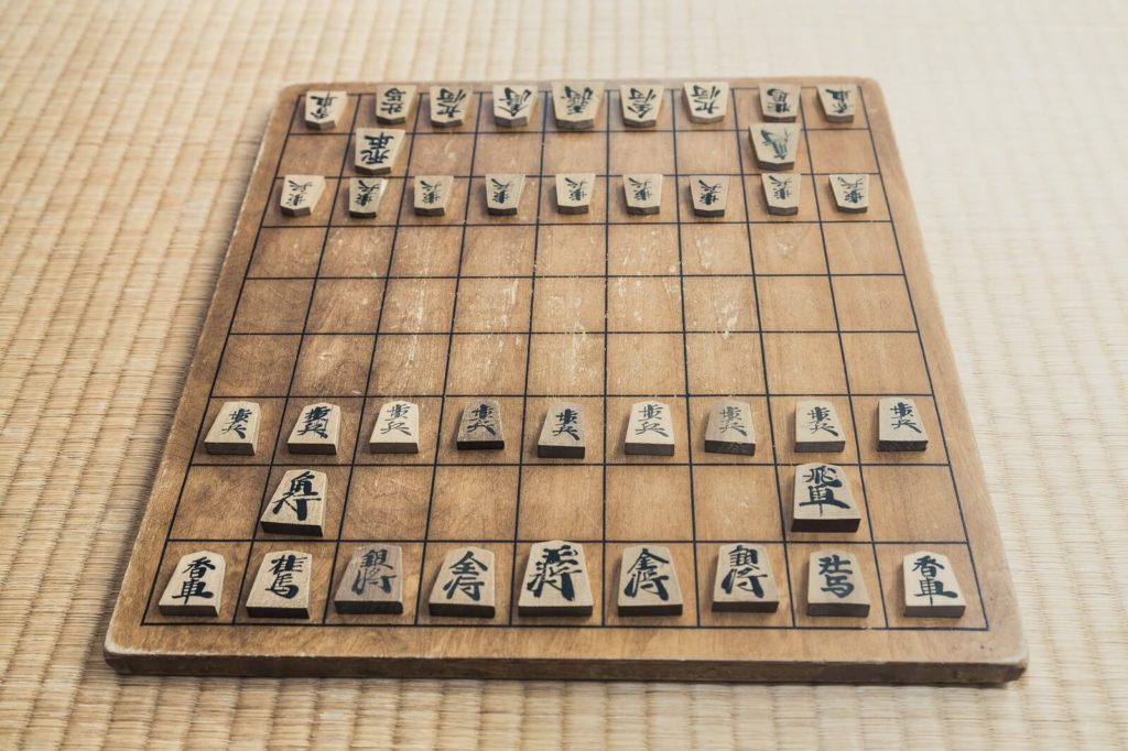 【Fig1 Peices and a board of shogi】